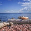 Rocky Lake Superior beach with a tanker boat